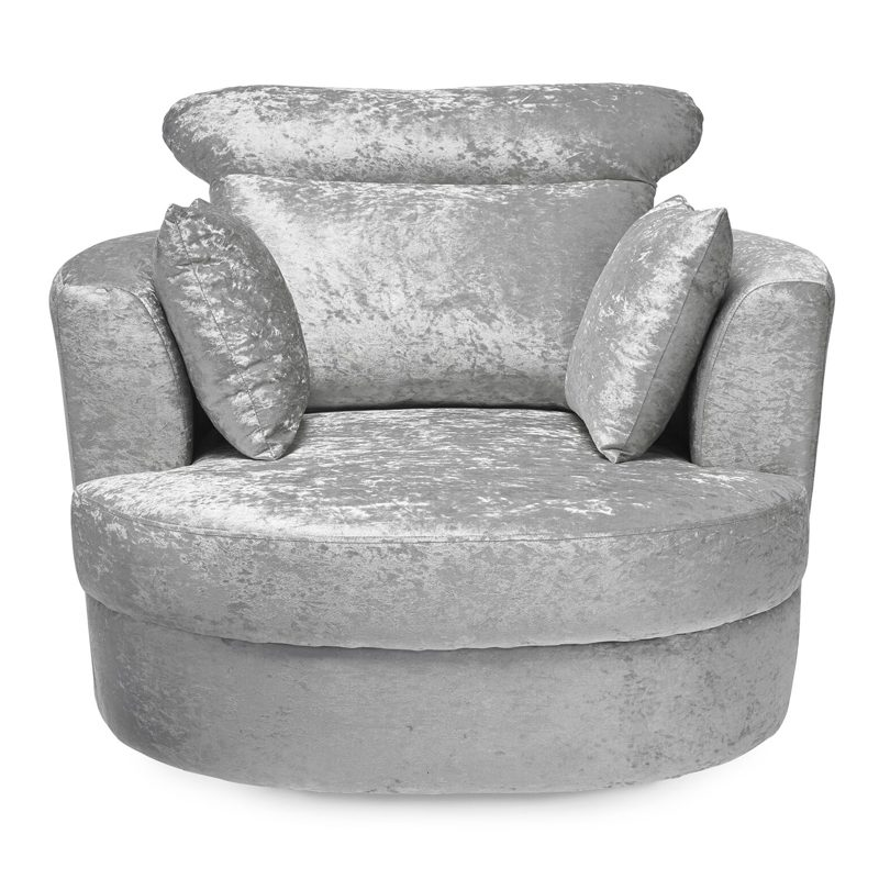 Large silver crushed velvet swivel chair with matching cushions