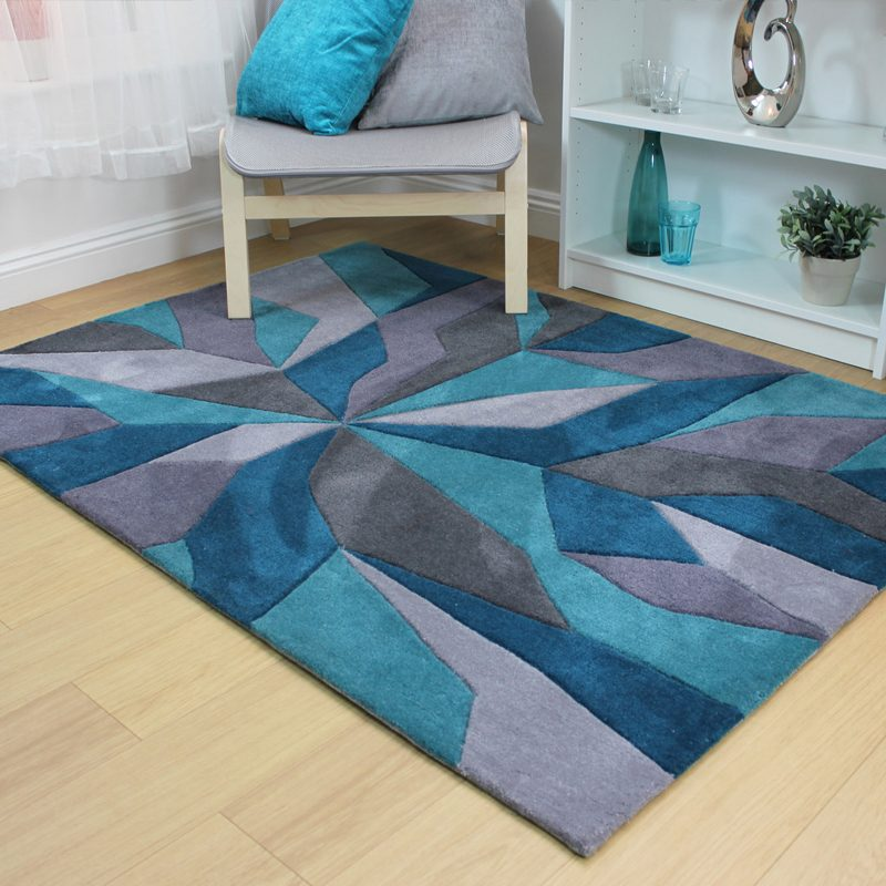 Modern rug in teal with burst design