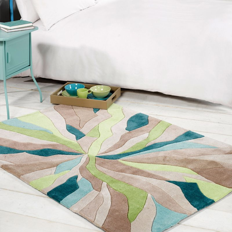 Green living room rug with shatter design