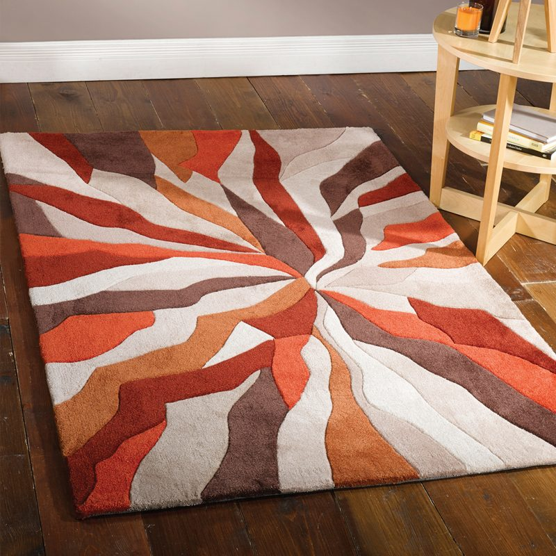 Orange living room rug with abstract pattern