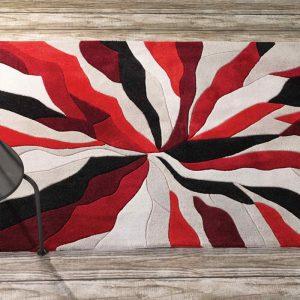 Red living room rug with shatter design