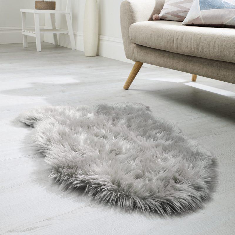 Grey faux fur rug in living room