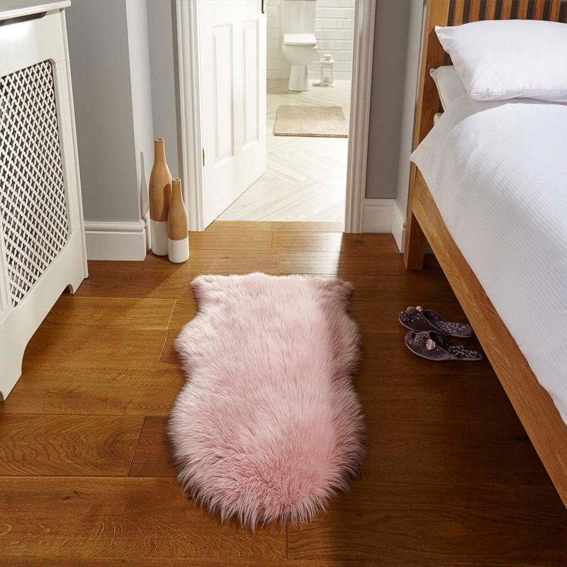 Pink faux fur rug