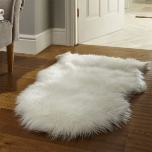 White faux fur rug in living room